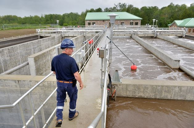 A picture of a man at a wastewater facility