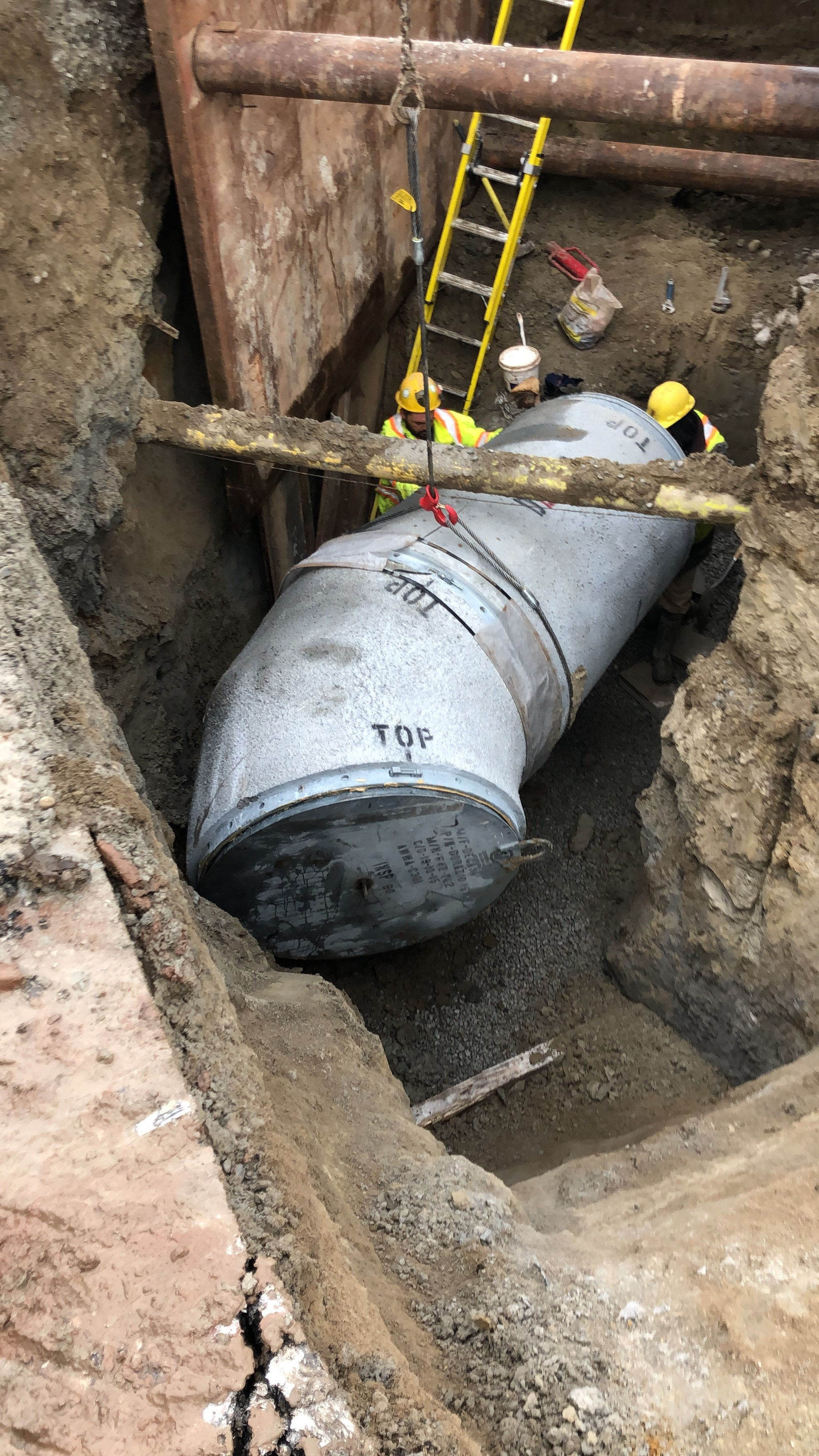 An image of a large water pipe buried in the ground