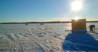 Ice fishing hut on a frozen lake