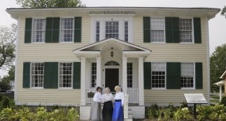 Three ladies in front of a heritage house