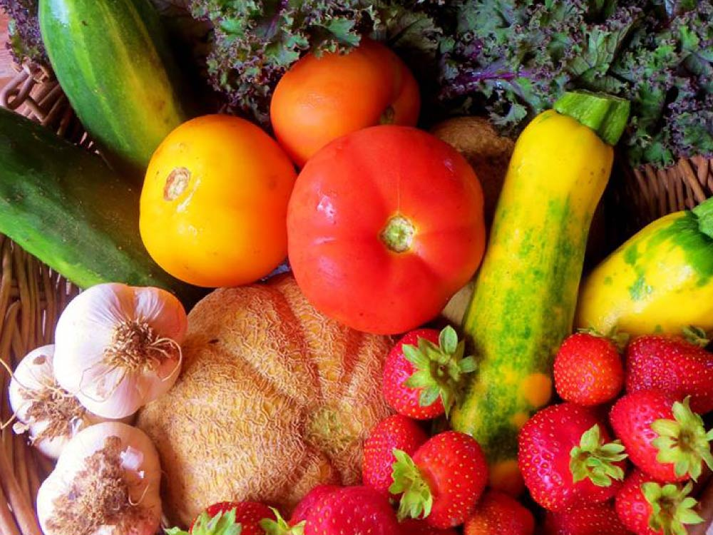 Close up of a variety of brightly coloured vegetables.