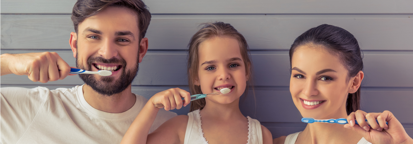 Family brushing their teeth.