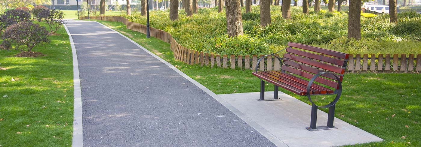 Park with a bench and walking path.