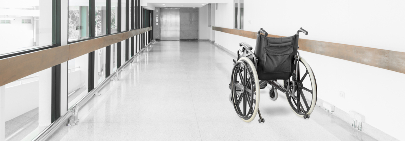 Wheelchair in the hallway of a health care facility.