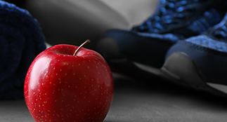 Apple, running shoes and exercise mat.