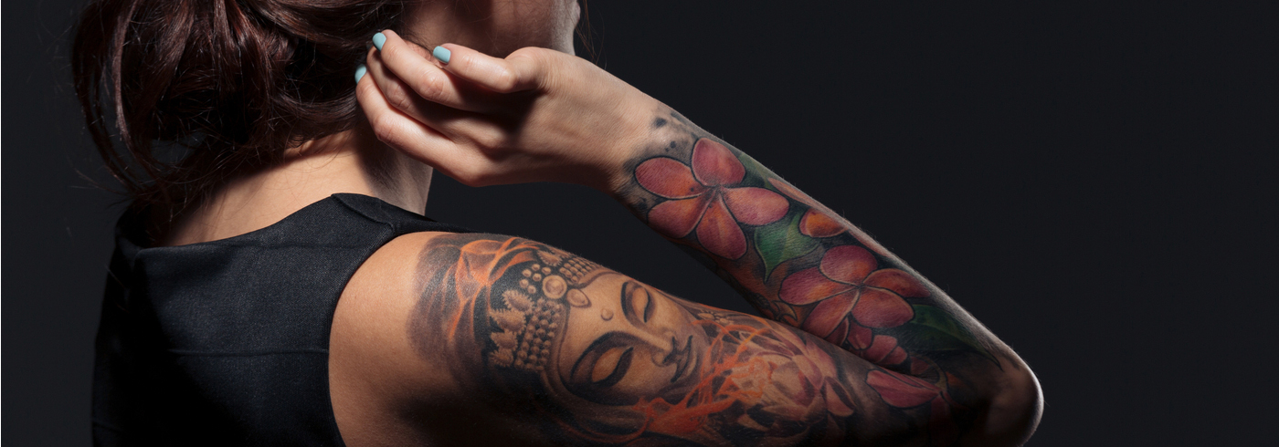 Woman with tattoos on her arm.