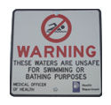 "Health Department issued ""unsafe for swimming"" sign."