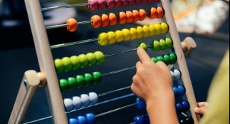 Child using abacus