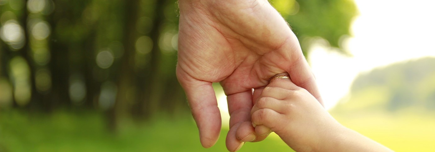 Child holding parents hand