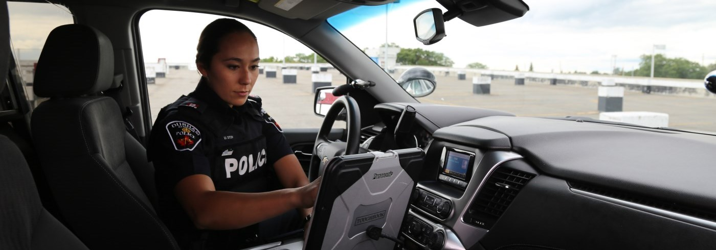 Female police officer in car