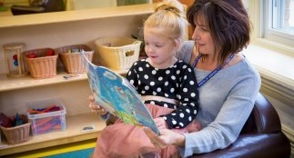 early childhood educator reading with a child