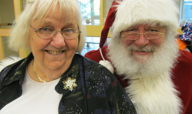 Elderly woman smiling with Santa