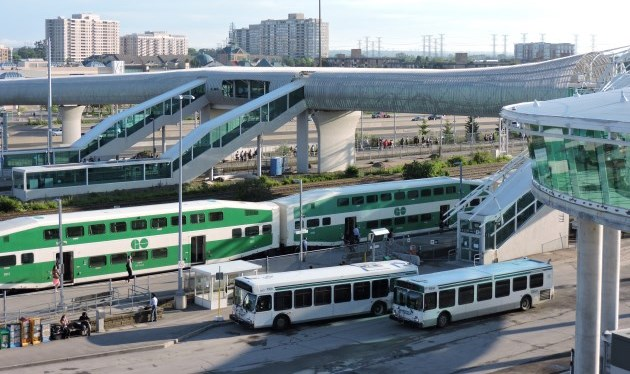 GO train and buses at station