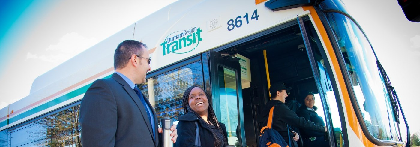 Man and woman getting on to Durham Region Transit bus