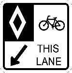 Ground-mounted sign indicating bicycle-only lane