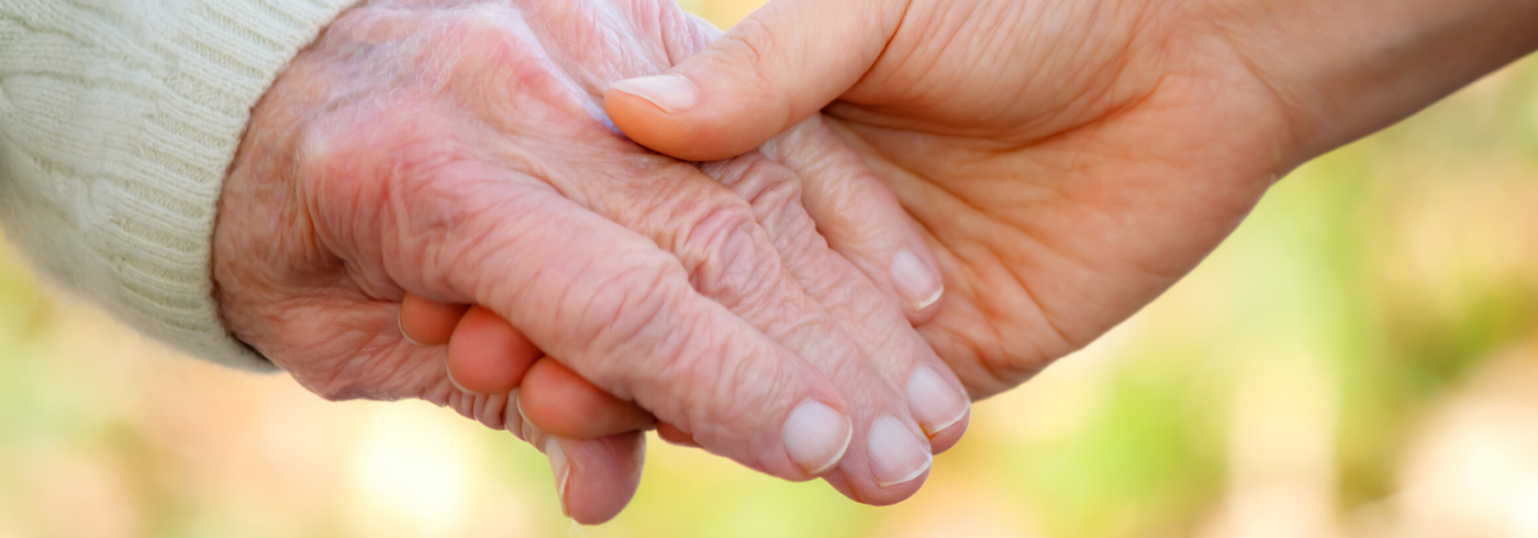 elderly person hand holding another hand