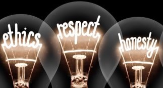 "Light bulbs with lit up words ""ethics"" ""respect"" and ""honesty"""