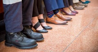 Employees feet in focus as they sit on a bench