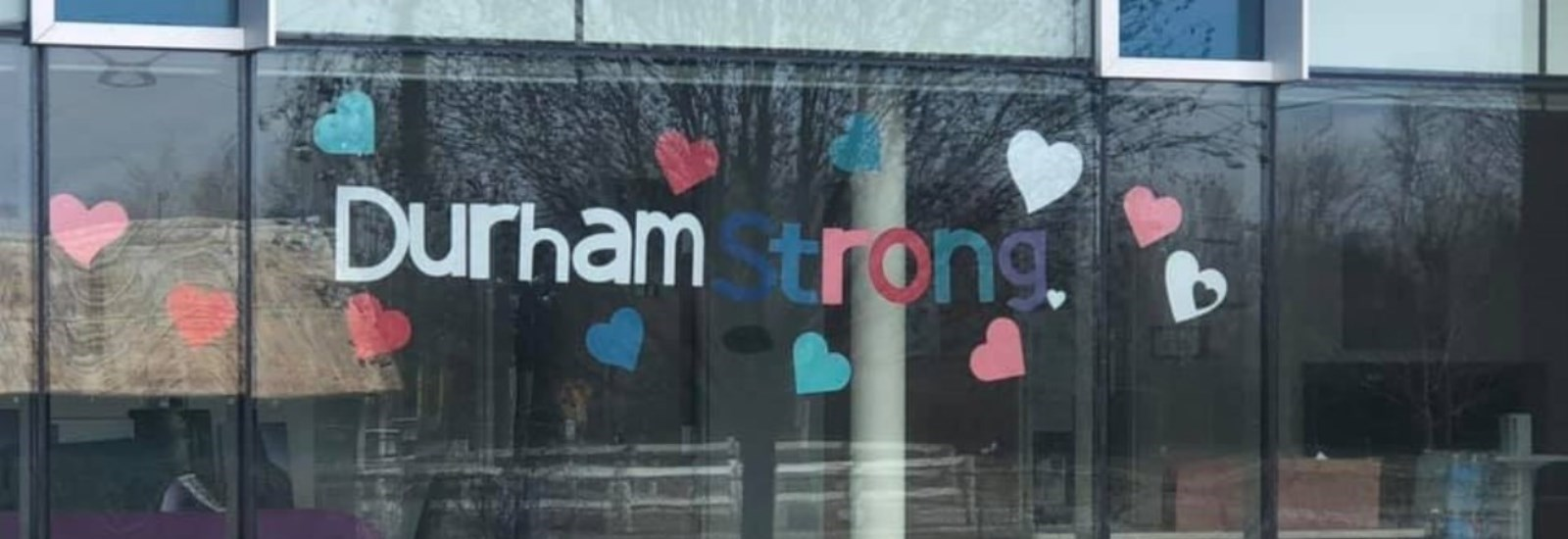 Durham Strong sign in Lakeview Manor window