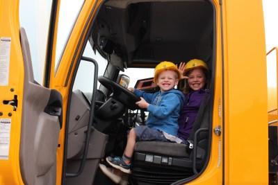 Children smiling in big truck
