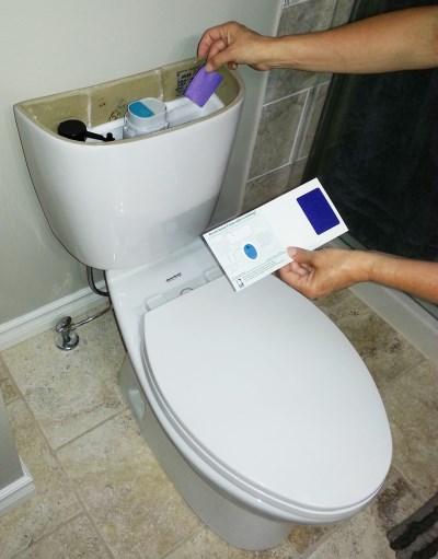 Toilet dye test strip being used
