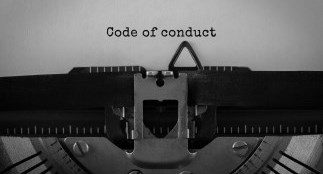 "Typewriter typing the words ""code of conduct"""